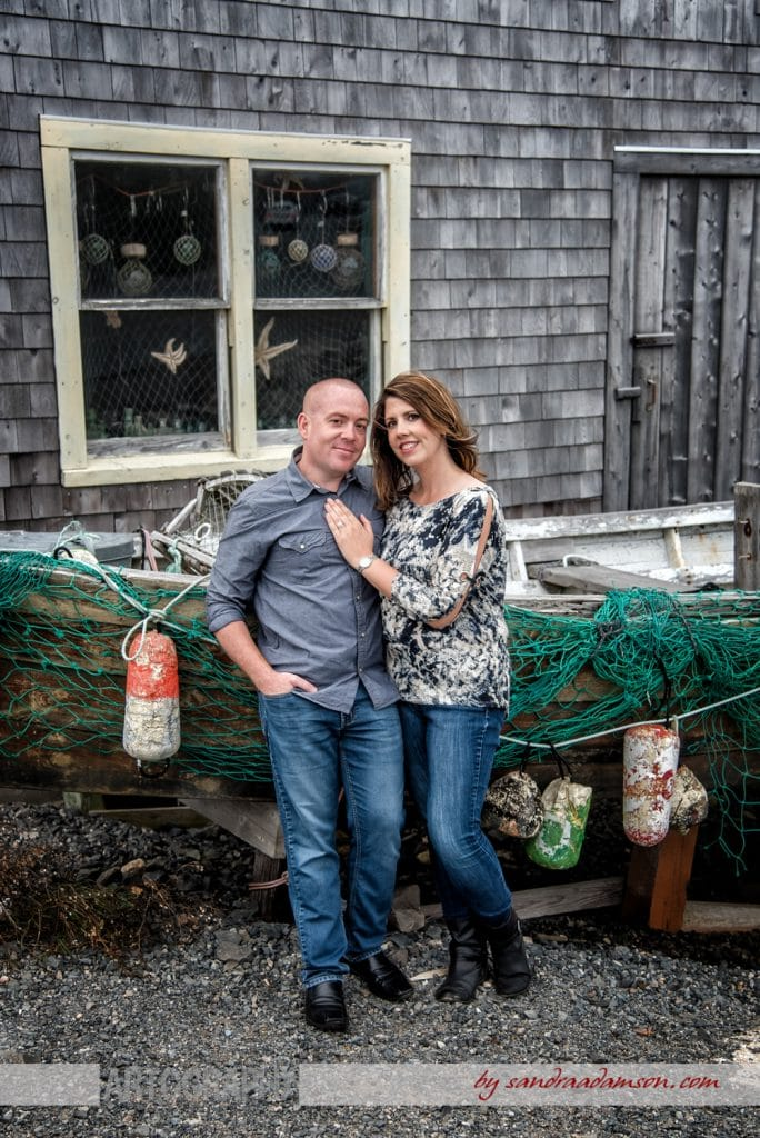 peggys cove, ns, nova scotia, engaged, engagement, photography, photographer, ocean, water, sea, rocks, ring, love, couple, boar, bouys, net, netting, fisherman