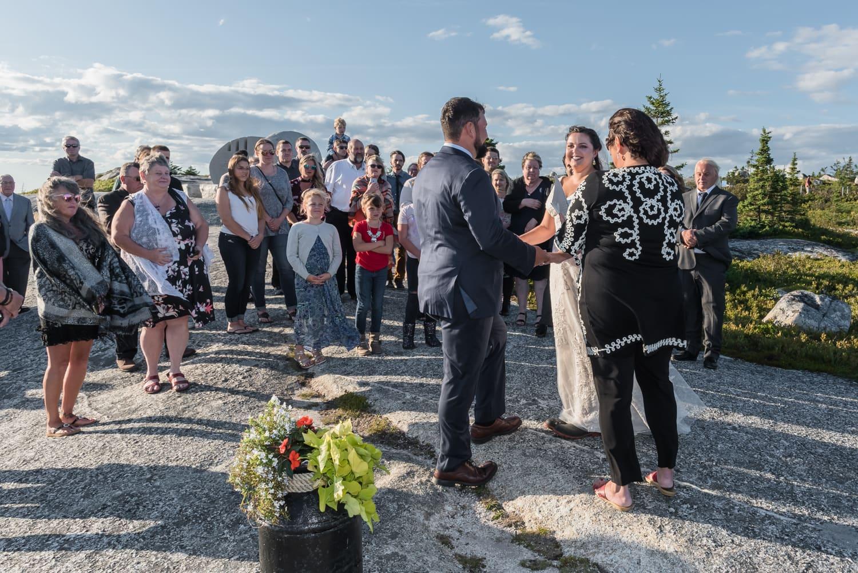 swiss air monument, wedding ceremony, bride, groom, wedding guests, ocean wedding