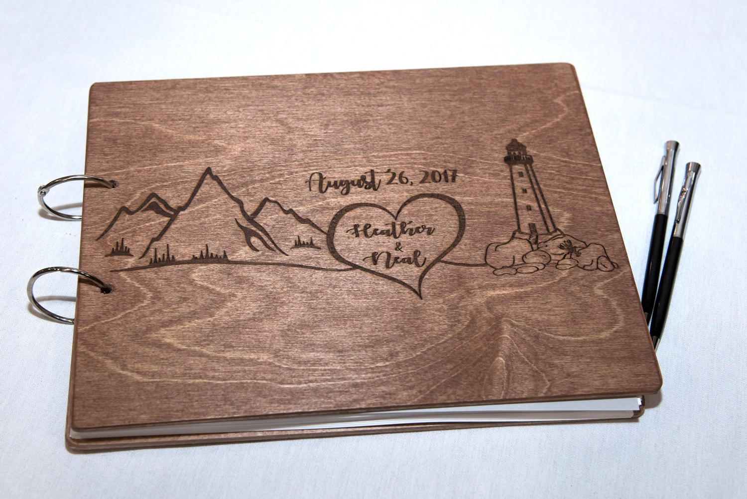 a wooden wedding guest book with pages for wedding guests to sign displayed at a Best Western Chocolate Lake wedding